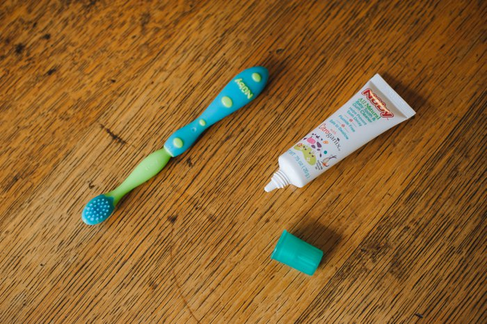 Brushing a Baby's Teeth - Tooth Brushing Tips for Babies - How to Brush a Baby's Teeth - Nuby Oral Care System Set and All Natural Baby Teeth and Gum Cleaner | Brush baby teeth, brush baby teeth tips, brush baby teeth when to start, when to start brushing baby teeth, brush baby gums.