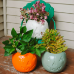 Cheap DIY Fall Porch Decor Idea - Painted $1 Plastic Pumpkins | One dollar Target Plastic Treat Buckets DIY Decorations