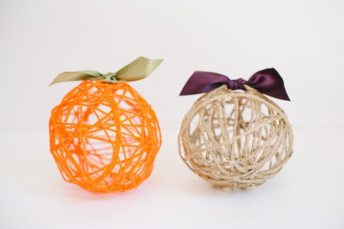 Turning yarn balloon balls into pumpkins for cheap fall decor