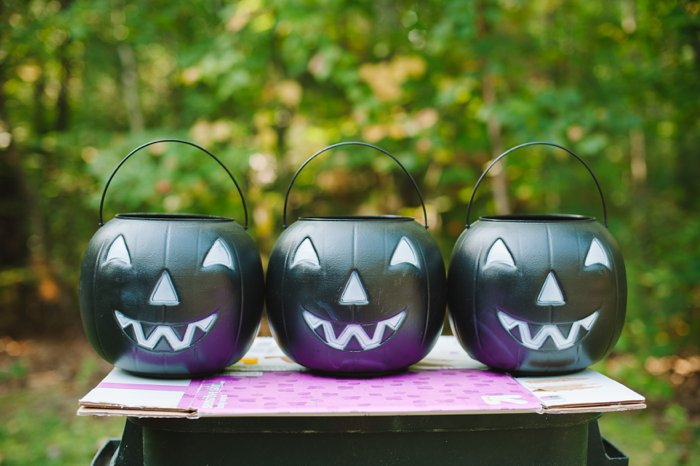 Turn plastic treat buckets into pretty porch decor