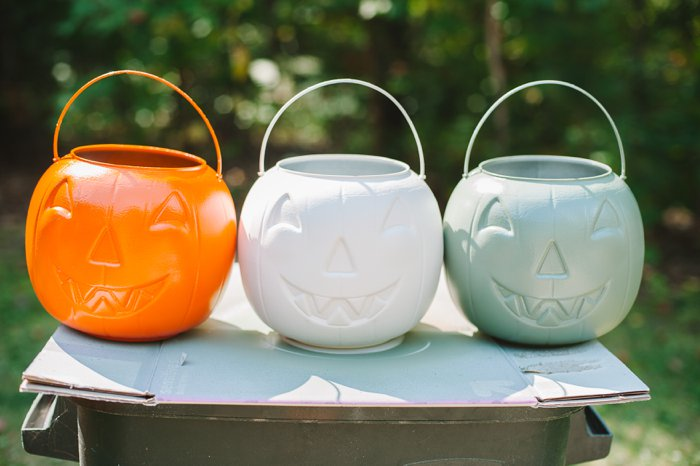 Spray paint plastic treat buckets for porch decor