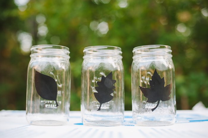 Vinyl leaf decals on mason jars for an easy fall decoration idea