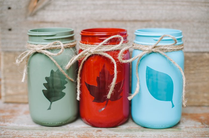 Fall mason jar craft idea with vinyl leaf cut outs and twine