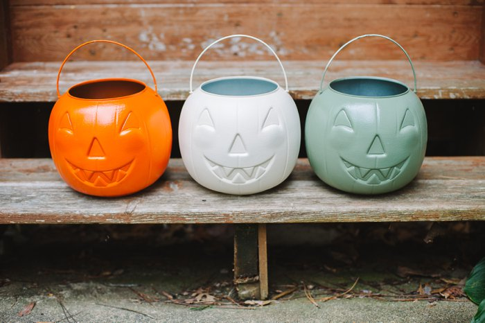 Spray paint plastic pumpkins for fall decorations