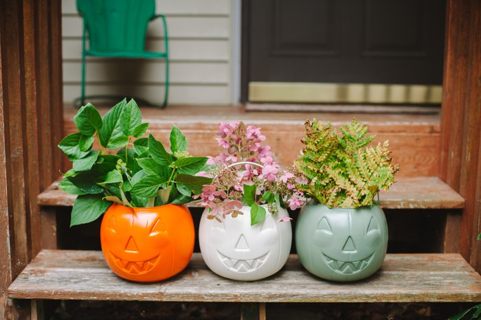 Pretty porch decor idea for fall with plastic pumpkins