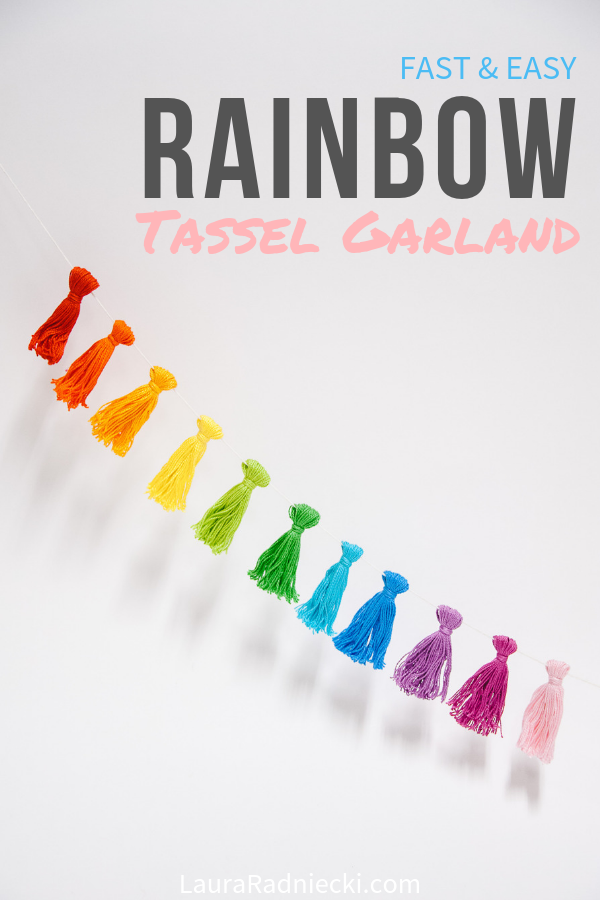 Learn how to make a DIY rainbow tassel garland using embroidery floss in this easy tutorial! It is quick, simple, and looks great in a kid\'s room or as fun birthday party decor! #rainbow #tassels #garland