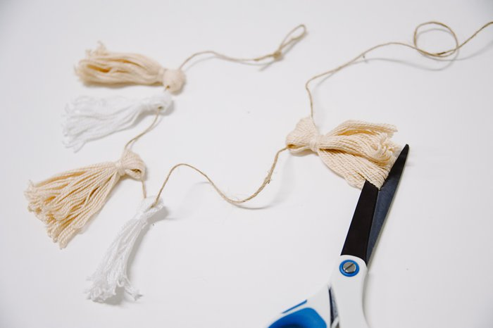 Cut the bottom of the embroidery floss for your diy christmas garland