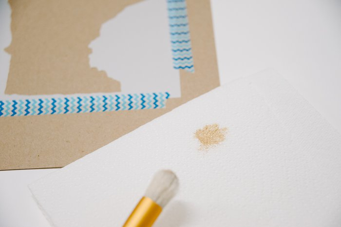 Remove excess paint from stencil brush