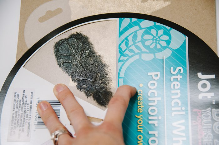 stencil a feather onto paper