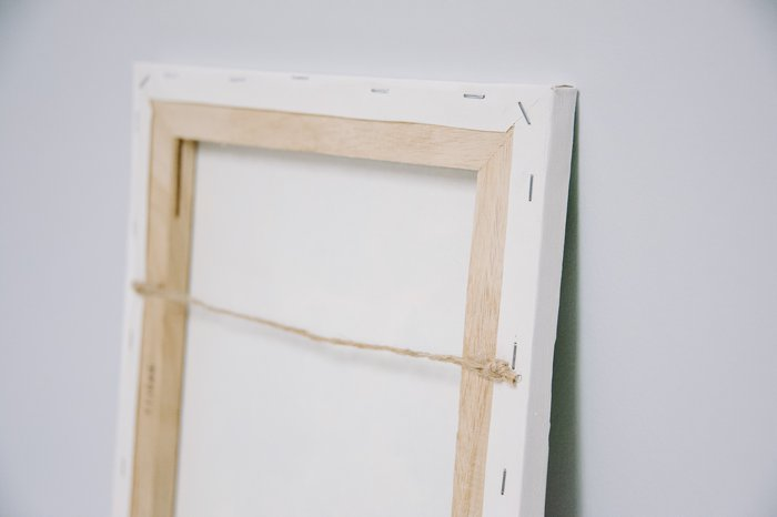 how to make your own canvas photos and hang with twine glued to the back