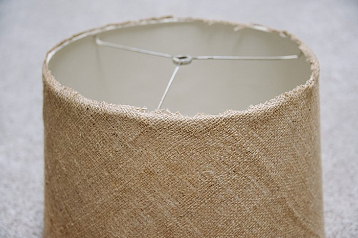 Hot glue edges of burlap down onto lampshade