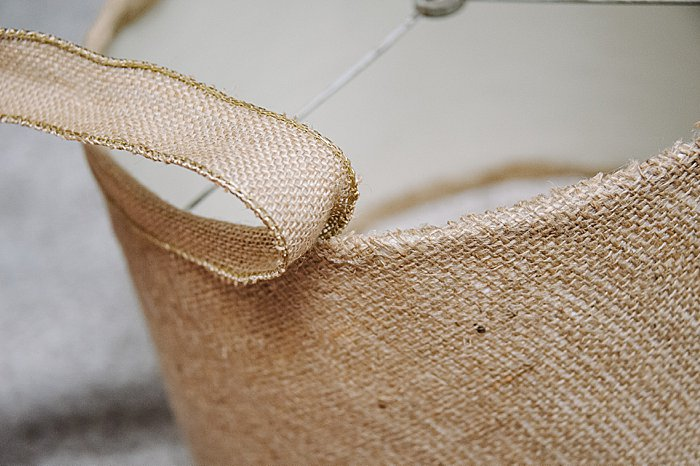 Use burlap ribbon to finish the edges of a diy lampshade makeover