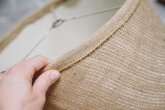 Hot glue burlap ribbon to lamp shade edges