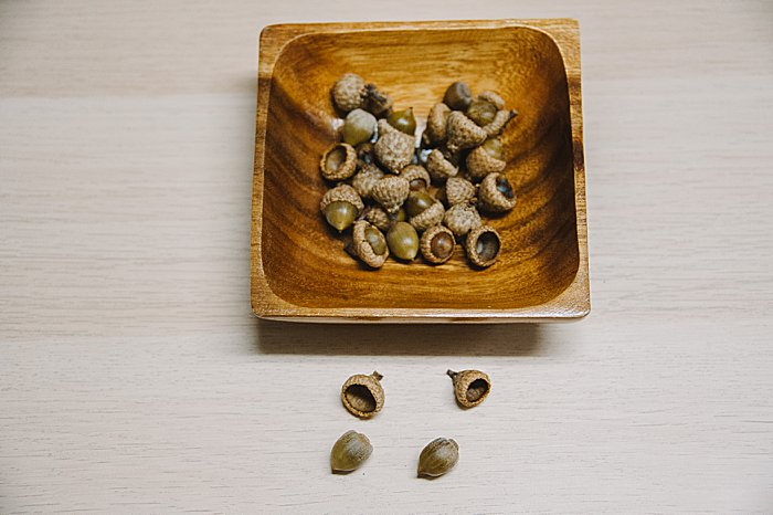 Preparing acorns for crafts may loosen some caps. They can be glued back on.