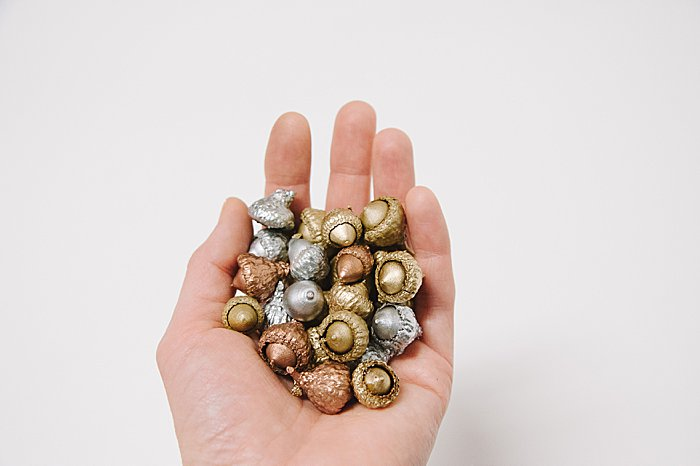 spray painted metallic acorns