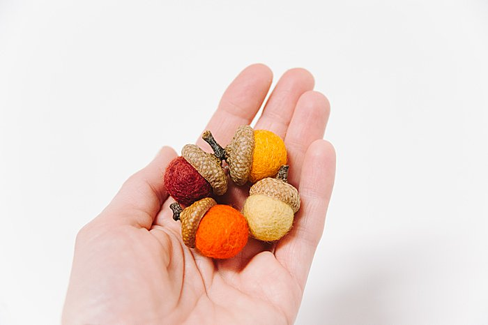 felt acorns made with felt balls and acorn caps