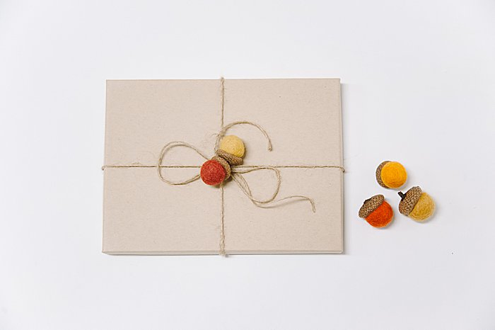 use felt ball acorns as decorative gift wrap embellishments