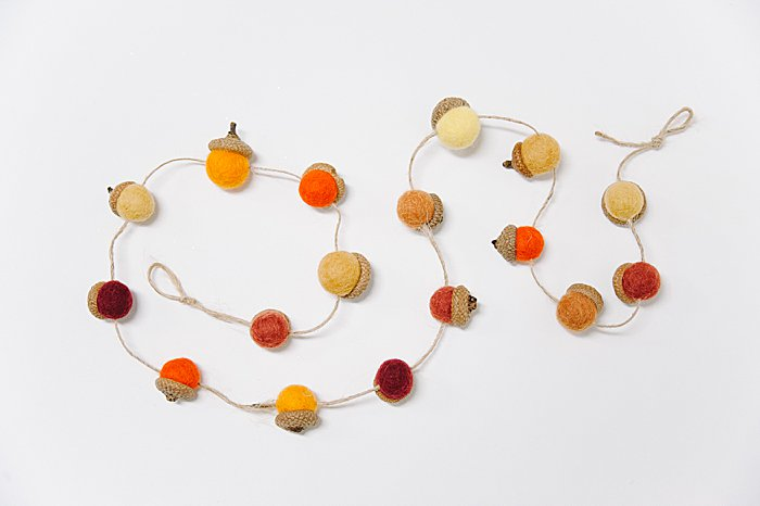 String felt acorns onto twine for a DIY fall garland