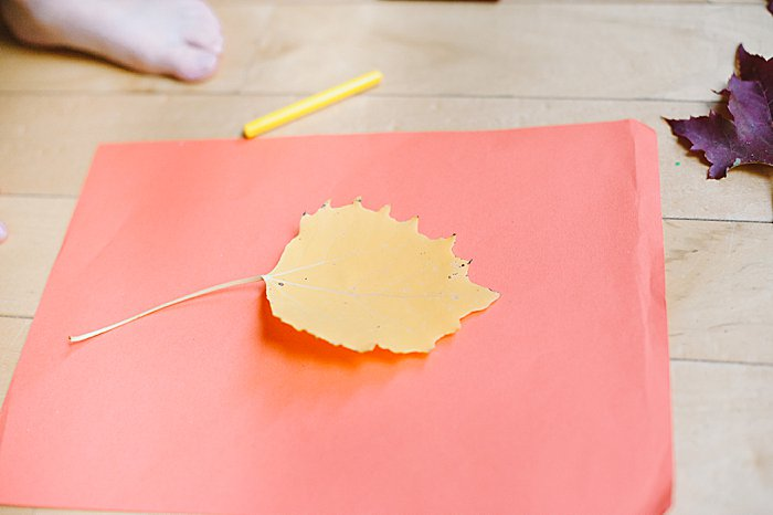 lay leaf down on hard surface for leaf rubbing craft