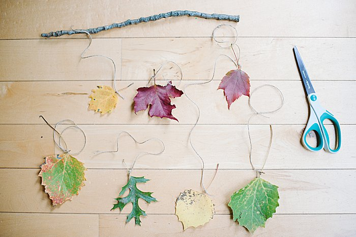 tie each piece of twine to the stick in the desired order for your fall wall hanging