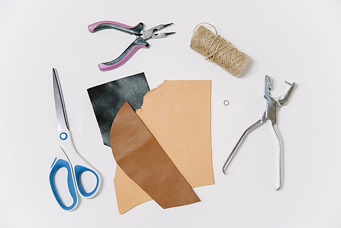 Supplies to make a DIY leather scrap Christmas ornament