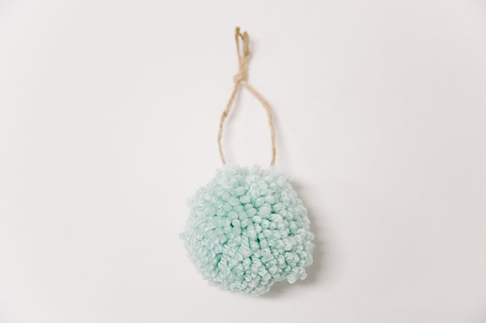 How to make a yarn pom pom ornament with a pom pom maker.