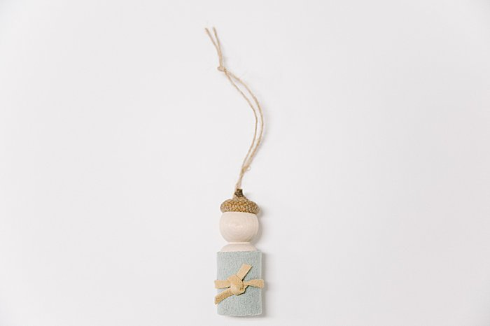 How to make a peg doll craft and acorn ornament combining them into a waldorf inspired peg doll ornament for Christmas