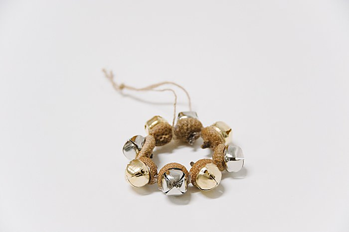 Ornament made with acorn caps and metal jingle bells