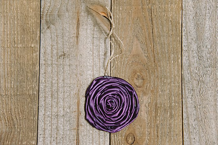A DIY rolled ribbon rose flower tutorial - how to make a rolled ribbon rosette