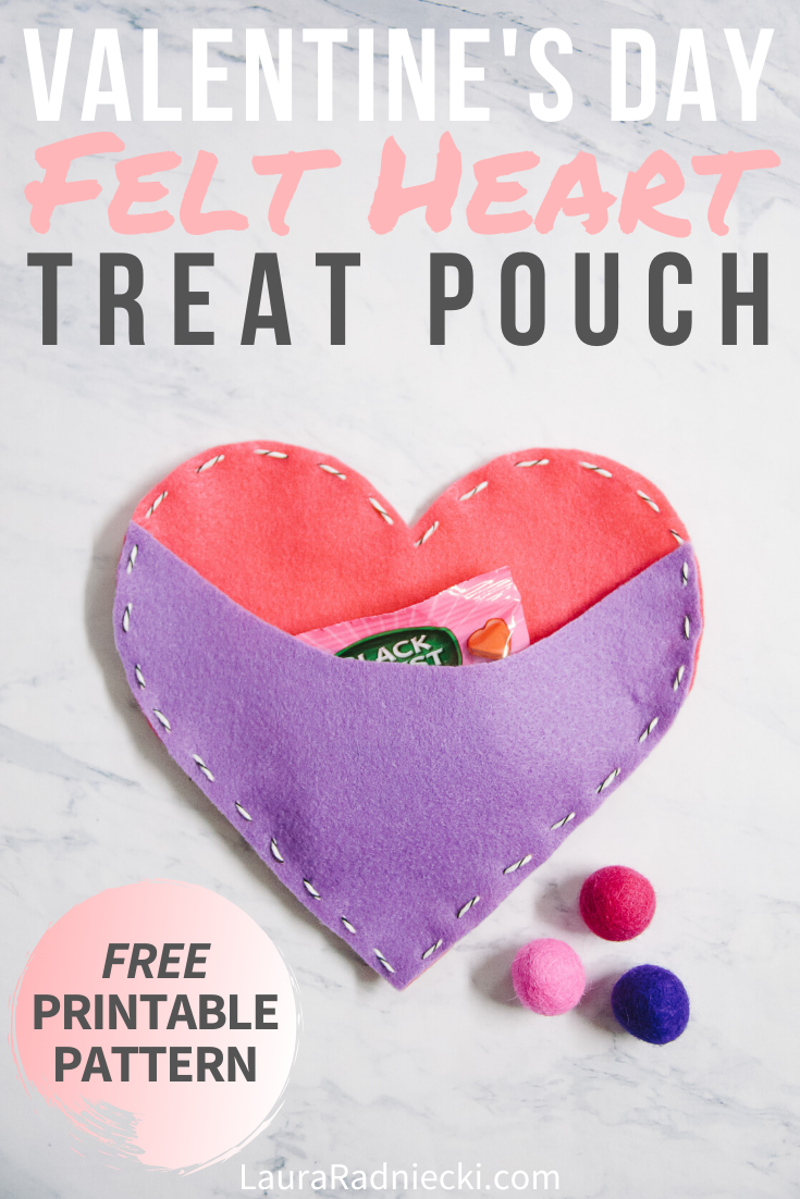 Looking for ideas of felt Valentine\'s Day crafts? Here\'s a DIY felt heart treat pouch that\'s made with simple felt heart shapes hand sewn together with baker\'s twine. You can add candy or a love note into the heart\'s pouch and it\'s ready for your Valentine. It\'s the perfect project for kids or adults! #valentine #felt #handsewn #lauraradniecki