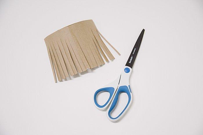 cut fringe in paper to make a diy tassel
