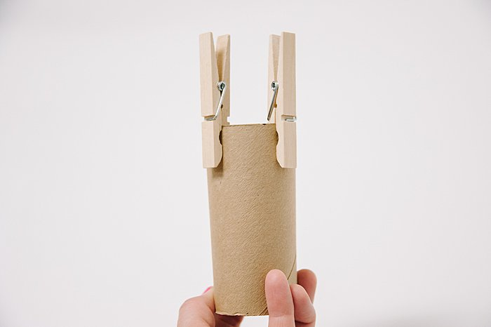 Clip clothes pins onto toilet paper rolls to make antlers for a deer