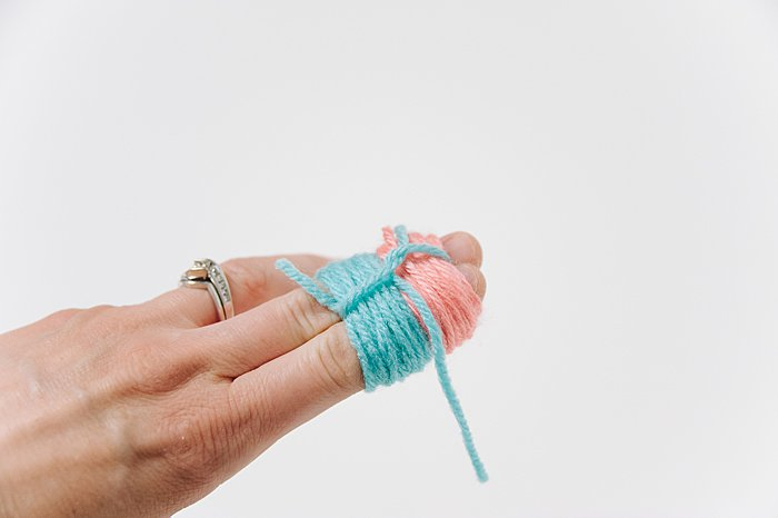 pom pom with two colors of yarn