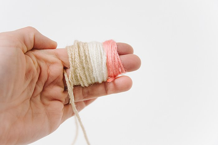 wrap three colors of yarn to make pom pom