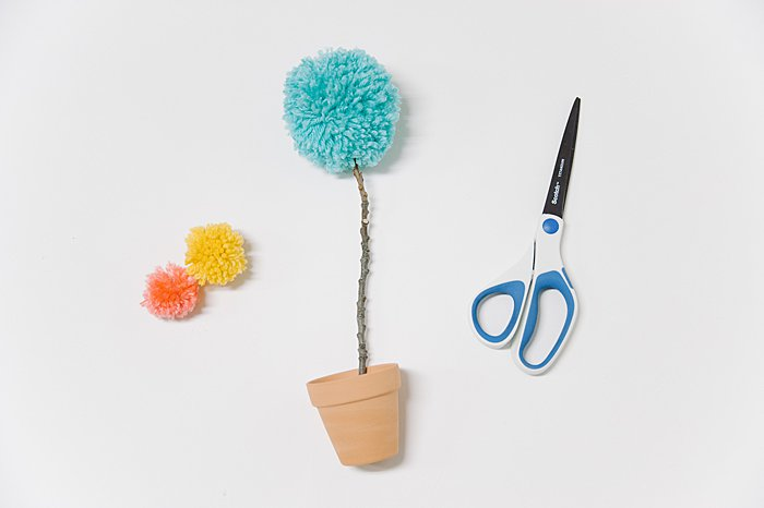 making a flower from a pom pom