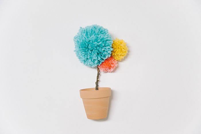 potted flower made with yarn pom poms