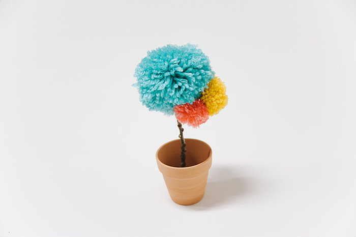 potted faux pom pom flower