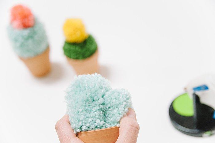 add yarn pompom to pot for cacti