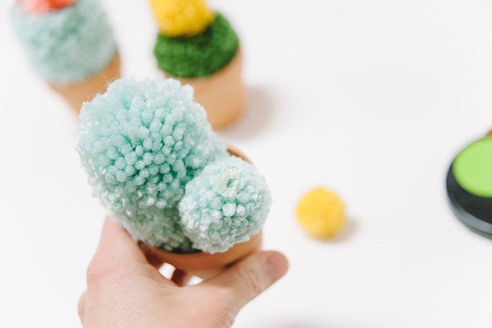 hot glue small pom pom onto top of cactus
