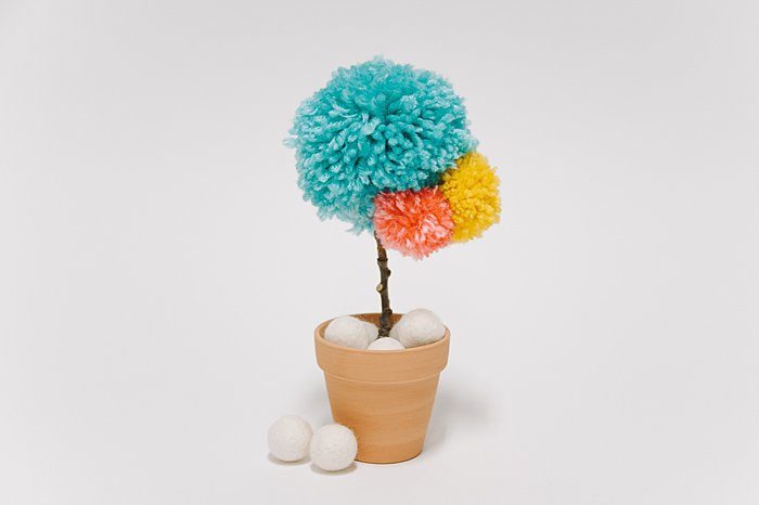 diy yarn pom pom flower in a mini clay pot