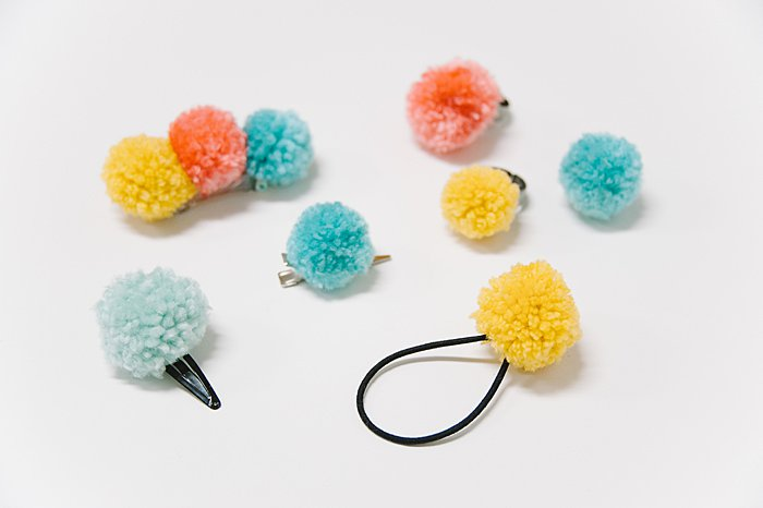 diy pom pom hair accessories, hair clips, barrettes, hair ties, and rings.