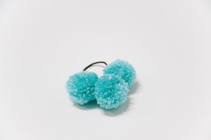 hair ties with pom poms on them