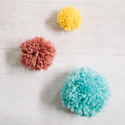 How to Make Yarn Pom Poms By Hand, Without a Pom Pom Maker