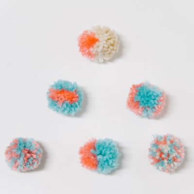 How to Make Multi-Colored Pom Poms | Easy Yarn Pom Pom Variations