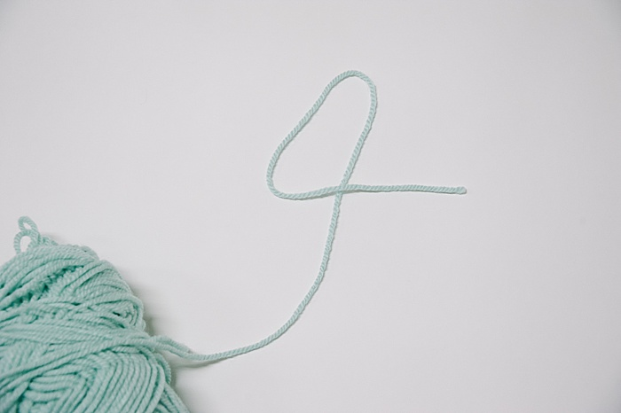 first step to make a slip knot, make a number four with the yarn
