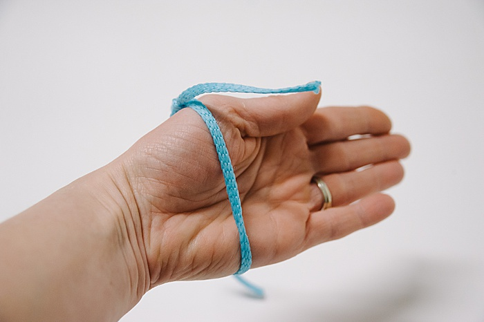 fit your sliding knot bracelet over the biggest part of your wrist before you tie the second knot