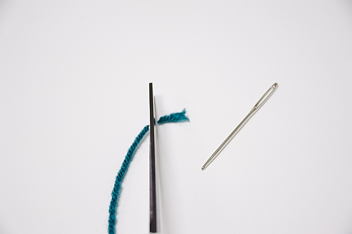 Cut off the frayed end of your string before threading your needle.