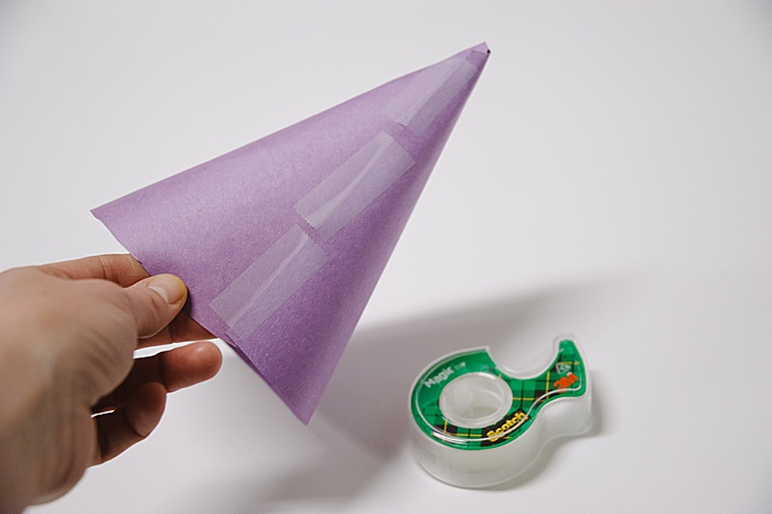 a paper cone secured with tape