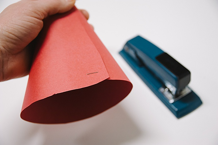 staple the edges of your paper cone to secure it into a cone shape