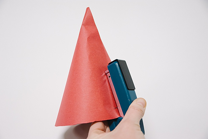 staple up the paper cone as high as you can